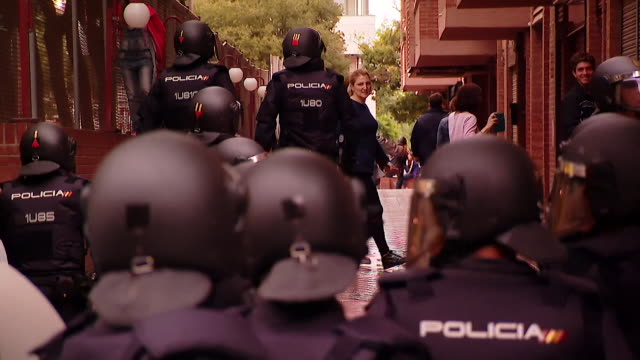 Spanish police clashing with Catalonians at a polling station during the controversial independence referendum