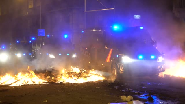spanish police seen moving through the streets during a general strike on october 18 2019 in barcelona spain earlier in the week the spanish supreme... - prison riot stock videos & royalty-free footage