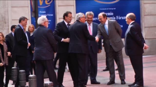 Spanish Prime Minister Mariano Rajoy offers the Nueva Economia Forum Award to the European Commission President JeanClaude Juncker during the Premio...