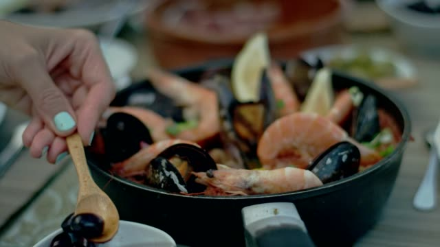 spanish seafood paella - black olive stock videos & royalty-free footage