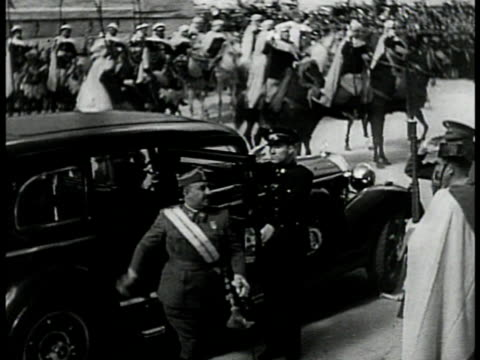spanish soldiers marching 'franco' sculpture sign bg ha ms generalismo francisco franco exiting car in parade ws crowd clapping ms franco saluting - 1939 stock videos & royalty-free footage