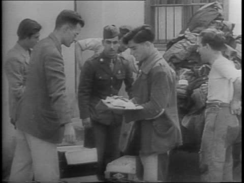 spanish soldiers walking through snow in pyrenees mountains / at an internment camp an allied soldier stands nearby a group of refugees in line / the... - allied forces stock videos & royalty-free footage