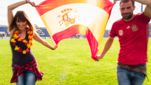 ms spanish sport fans at soccer stadium - spanish flag stock videos and b-roll footage