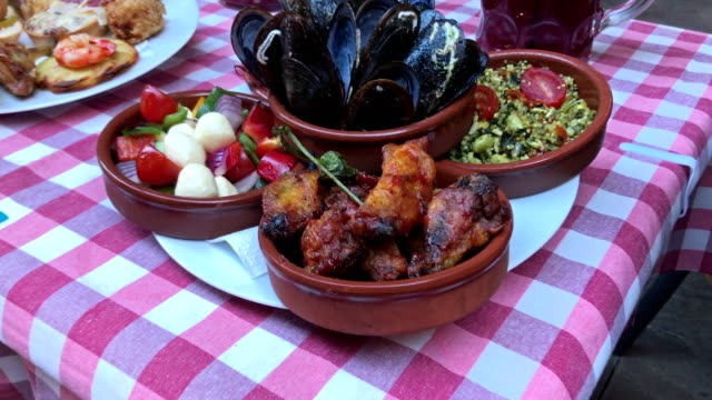 spanish tapas table - croquette stock videos and b-roll footage