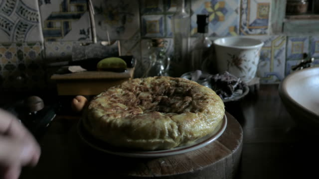 spanish tortilla homemade with windows light in a kitchen - raw potato stock videos & royalty-free footage