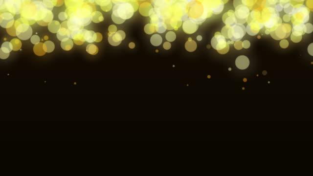 funkenbildung gold bokeh hintergrund mit flare light für motion-design-arbeiten - silberfarbig stock-videos und b-roll-filmmaterial