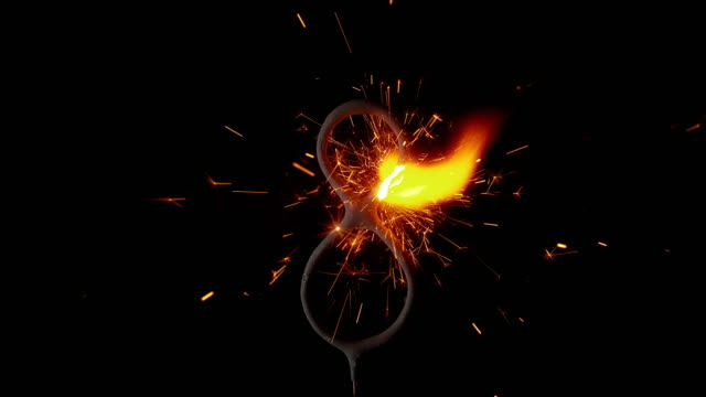 slo mo ld sparkle stick in shape of number eight emitting sparks - number 8 stock videos & royalty-free footage