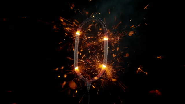 slo mo ld sparkle stick shaped as number zero emitting sparks - zero stock videos & royalty-free footage