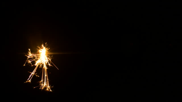 sparkler. a hand-held firework. - firework explosive material stock videos & royalty-free footage