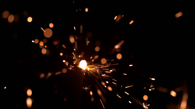 slo mo sparkler against beautiful bokeh background - advent stock videos & royalty-free footage