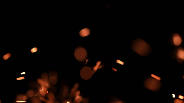 slo mo sparkler burning out against black background - sparks stock videos & royalty-free footage