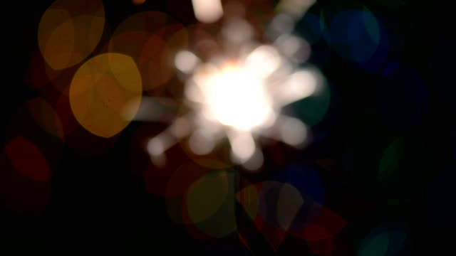 sparkler close up,bukeh - firework explosive material stock videos & royalty-free footage