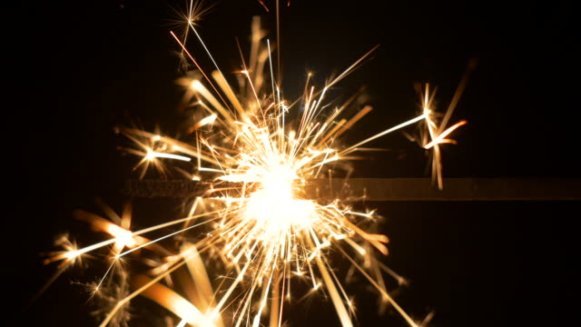 sparkler close-up. a hand-held firework. - firework explosive material stock videos & royalty-free footage