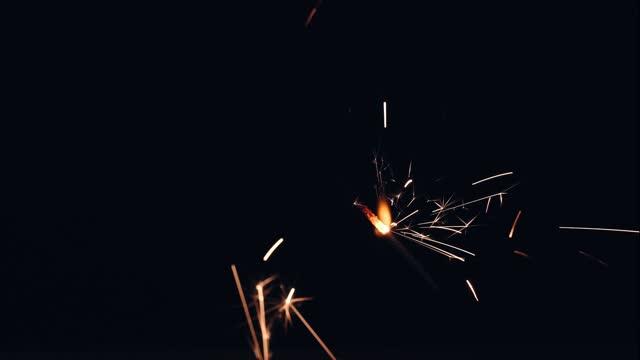 sparkler fireworks against black background - plain background stock videos & royalty-free footage