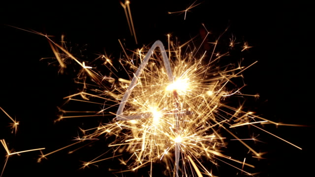 sparkler four close up hd (2014) - number 4 stock videos & royalty-free footage