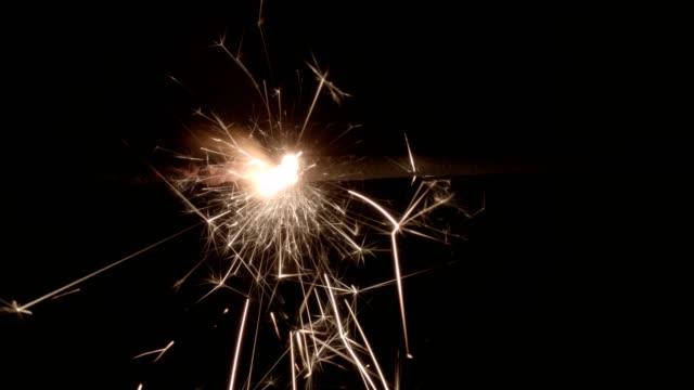 sparkler on black background - sparkler stock videos & royalty-free footage