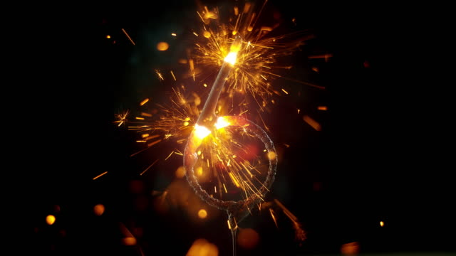 slo mo ld sparkler shaped as the 'number 6' emitting sparks and flames while burning - number 6 stock videos & royalty-free footage