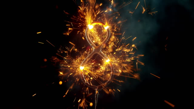 slo mo ld sparkler shaped as the 'number 8' emitting sparks and flames while burning - number 8 stock videos & royalty-free footage