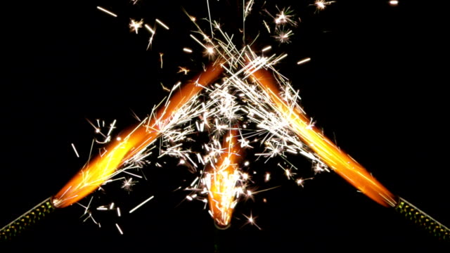 sparklers burning - three objects stock videos & royalty-free footage