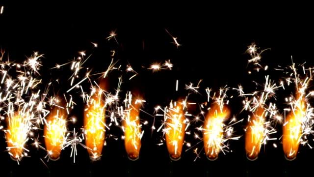 sparklers burning - colore isolato video stock e b–roll