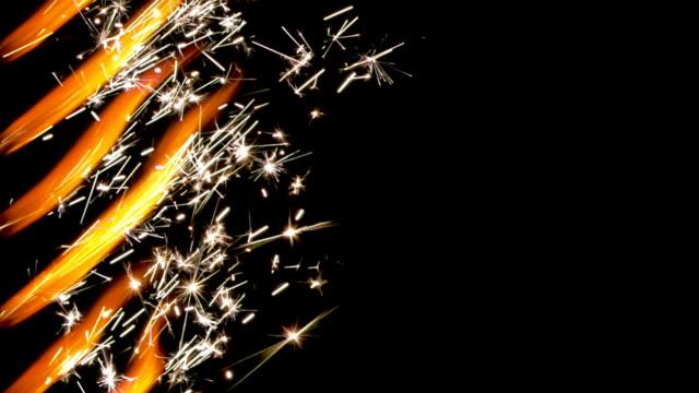 vídeos de stock e filmes b-roll de sparklers burning - cor isolada
