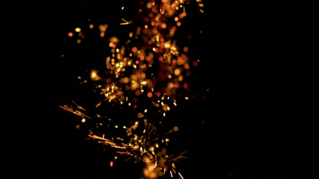 slo mo sparkles of a firecracker on black background - sparks stock videos & royalty-free footage