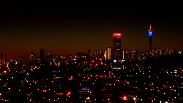 ws ha sparkling city skyline at dusk / johannesburg/ south africa - image stock videos & royalty-free footage
