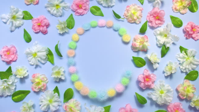 sparkling letter c- exploding multi pastel colored glitter powder surrounded by cherry blossoms and leaves on pastel blue background - pastel stock videos & royalty-free footage