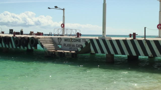 WS Sparkling Water and Welcome Sign on Pier / Playa Del Carmen, Mexico