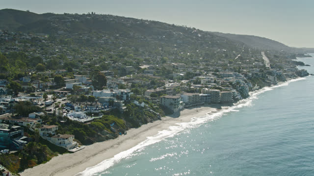 sparkling waves lapping the coastline at laguna beach, ca - aerial - laguna beach california stock videos & royalty-free footage