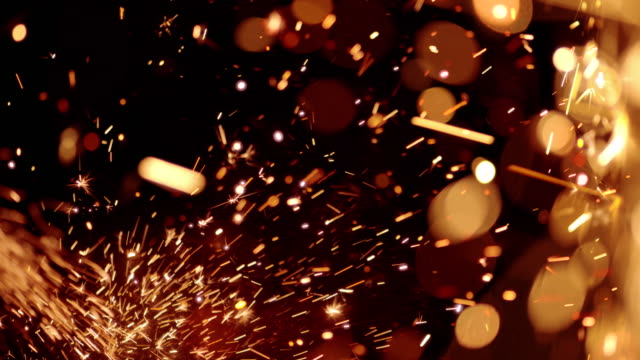 sparks abstract video background. 4k - orange colour stock videos & royalty-free footage