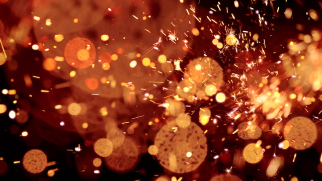 sparks abstract video background. 4k - firework display stock videos & royalty-free footage