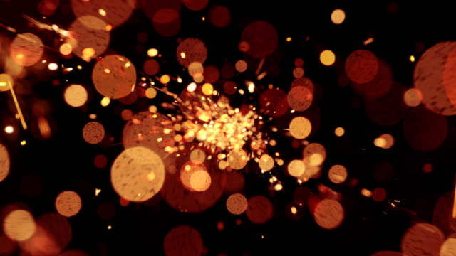 sparks abstract video background. 4k - orange stock videos & royalty-free footage
