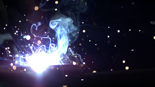 vídeos de stock, filmes e b-roll de slo mo sparks and gasses forming at welding - soldador