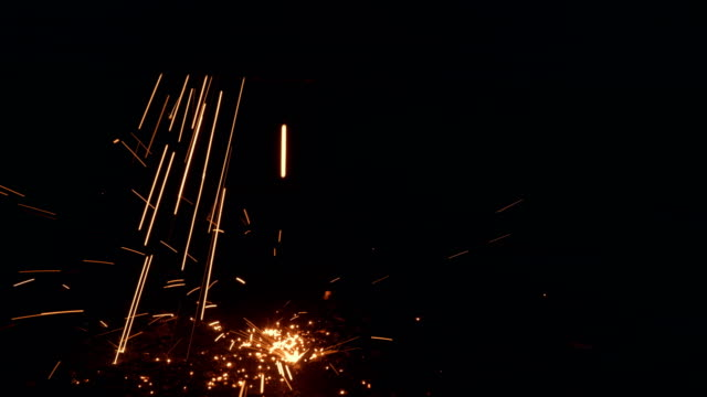 Sparks falling on the floor in metal cutting process