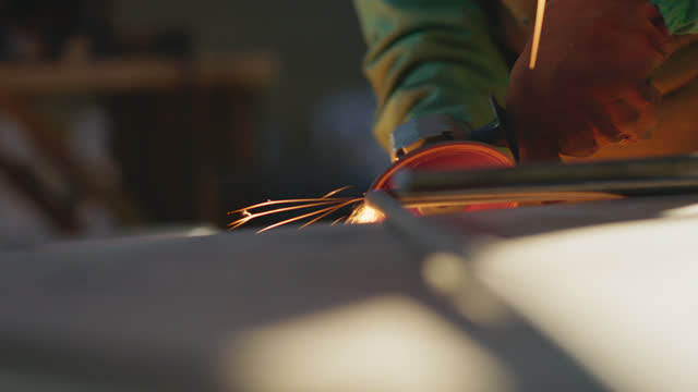 cu sparks fly as a metal worker grinds down a metal pipe with an angle grinder - metalwork stock videos & royalty-free footage