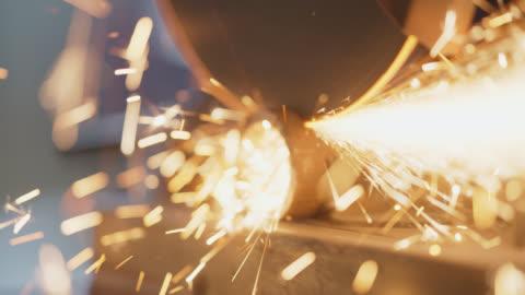 cu sparks fly as circular saw cuts through steel tubing - rohmaterial stock-videos und b-roll-filmmaterial