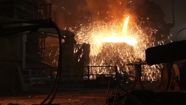 sparks fly as molten steel is poured from a ladle at an arc furnace in the steel melting shop of the jindal steel power ltd plant in raigarh... - steel stock videos & royalty-free footage