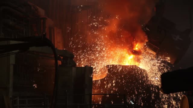 sparks fly as molten steel is poured from a ladle at an arc furnace in the steel melting shop of the jindal steel & power ltd. plant in raigarh,... - steel stock videos & royalty-free footage