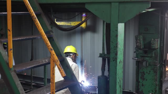 Sparks fly as workers assemble a shipping container in the welding shop at the SingamasContainer Holdings Ltd factory in Qidong China on Thursday...
