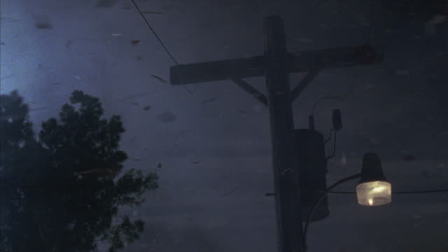 vídeos de stock, filmes e b-roll de sparks fly from a power line during a tornado. - meteorologia
