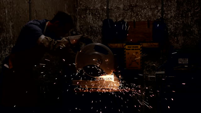 sparks fly from saw cutting a piece of metal - toughness stock videos and b-roll footage