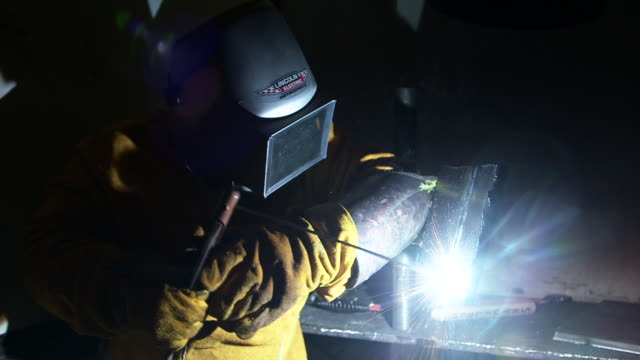 sparks fly man uses grinder on metal - respiratory equipment stock videos & royalty-free footage