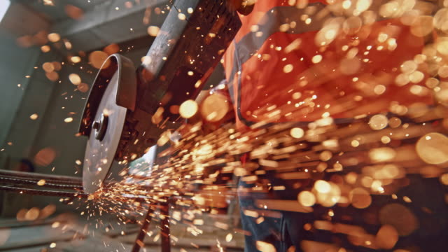 slo mo sparks flying from an angle grinder towards the camera lens - construction stock videos & royalty-free footage