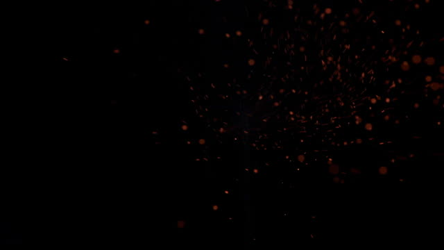 Sparks flying towards camera (slow motion)