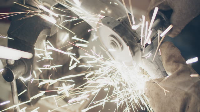 cu sparks flying while mechanic uses a grinder - repairing stock videos & royalty-free footage