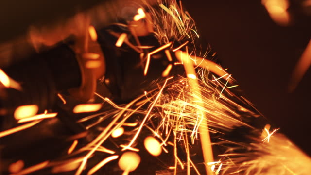 sparks from steel cutter - steel mill stock videos & royalty-free footage