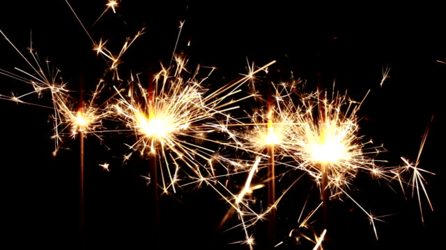 sparks over black - firework explosive material stock videos and b-roll footage