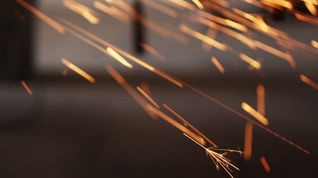 stockvideo's en b-roll-footage met sparks shoot from construction equipment - smeden