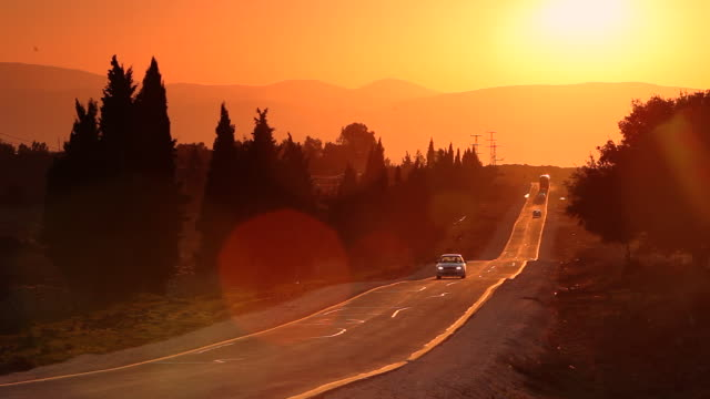 sparse traffic moves down a road in golan heights. - israel stock videos & royalty-free footage